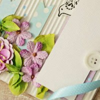 Decorative flowers, buttons and ribbons on a card.