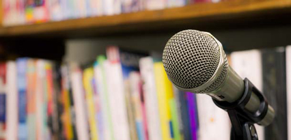 Microphone in front of book shelves