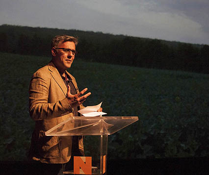 Photo of poet Daljit Nagra speaking at a lecturn