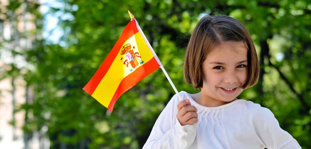 young girl holding spanish flag