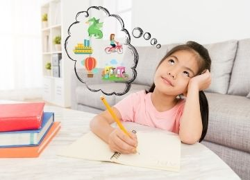 Young girl holding a pen with a thought bubble over her head with her imagining different things to write about.