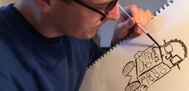 Artist Tom Armstrong drawing a comic book character
